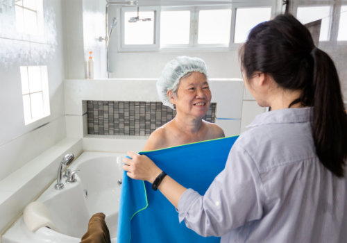 caregiver support elder woman taking a shower in bathroom