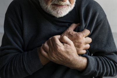 elderly man is having a chest pain